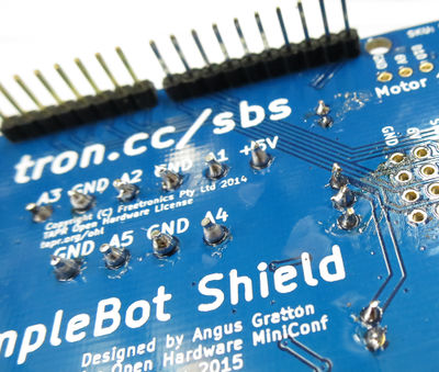 SimpleBot regulator and capacitors trimmed.jpg